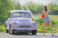 WEATHER PICTURE WALES<br /> Pictured: Natasha Jenkins washes her vintage Morris Minor car at her home near Neath, Wales, UK. Thursday 23 April 2020