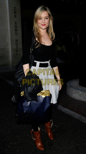 "LAURA WHITMORE.At the ""I Love You Man"" VIP Screening, Soho Hotel, London, England, UK, .April 8th 2009..full length brown ankle boots black top skirt belt tights  bag grey gray .CAP/CAN.©Can Nguyen/Capital Pictures"