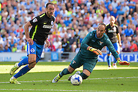 Glenn Murray of Brighton & Hove Albion (left) dribbles with the ball towards Ivan Vargic of Lazio during the Friendly match between Brighton and Hove Albion and Lazio at the American Express Community Stadium, Brighton and Hove, England on 31 July 2016. Photo by Edward Thomas / PRiME Media Images.