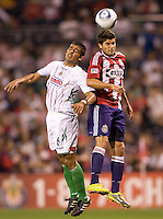 Chivas de Guadalajara defender Miguel Ponce and Chivas USA midfielder Sal Zizzo meet in the air for a ball. Chivas USA and CD Chivas de Guadalajara played to a 0-0 draw at Petco Park stadium in San Diego, California on Tuesday September 14, 2010.