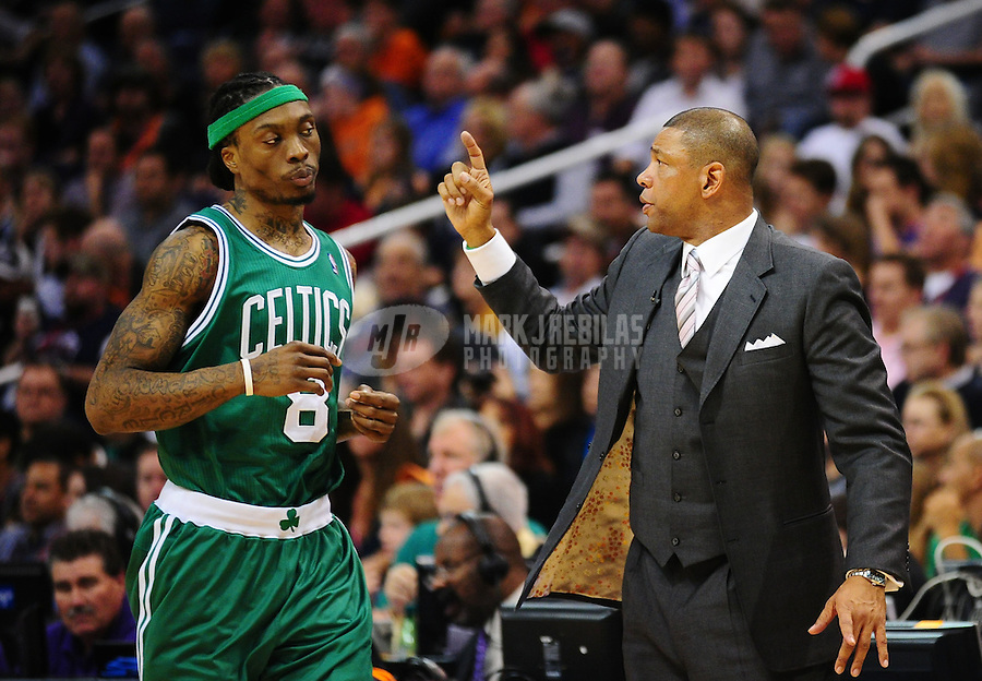 Jan. 28, 2011; Phoenix, AZ, USA; Boston Celtics guard Marquis Daniels and head coach Doc Rivers against the Phoenix Suns at the US Airways Center. Mandatory Credit: Mark J. Rebilas-