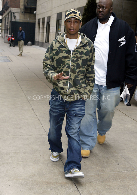 ** EXCLUSIVE** Hip Hop musician Pharrell Williams leaving his Manahattan Hotel. New York City.  March 03 2004. Please byline: ACE Pictures.   ..*PAY-PER-USE*      ....IMPORTANT: Please note that our old trade name, NEW YORK PHOTO PRESS (NYPP), is replaced by our new name, ACE PICTURES. New York Photo Press and ACE Pictures are owned by All Celebrity Entertainment, Inc.......All Celebrity Entertainment, Inc:  ..contact: Alecsey Boldeskul (646) 267-6913 ..Philip Vaughan (646) 769-0430..e-mail: info@nyphotopress.com