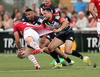 Matt Garside (R) of London gets to grips with Lee Smith during the Kingstone Press Championship game between London Broncos and Leigh Centurions at Ealing Trailfinders, Ealing, on Sun June 26,2016