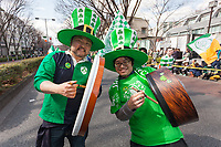 "Japanese people play traditional Irish music at the 27th Saint .Patrick's Day Parade in Omotesando, Tokyo, Japan. Sunday March 17th 2019. Started in 1992 by the Irish Network, Japan, and supported by the Embassy of Ireland,; the parade, along with the ""I Love Ireland Festival"" held nearby is Asia's  largest Irish event."