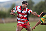 Simione Saravanua puts a fend on as he makes a run down the right wing. Counties Manukau Club rugby Premier game between Drury and Karaka played at Drury on Saturday May 1st, 2010. Karaka won the game 32 -12 after leading 25 - 7.