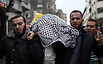 Mourners carry the body of Palestinian Amer Al-Hajjar, who was died of his wounds on 30 March 2018, during clashes in tents protest where Palestinians demand the right to return to their homeland at the Israel-Gaza border, during his funeral in Gaza city, on January 20, 2020. Photo by Mahmoud Ajjour