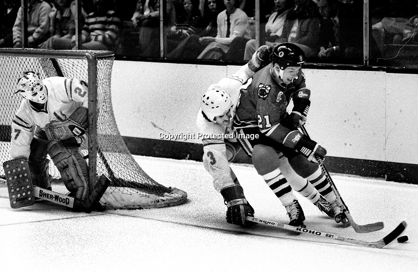 California Golden Seals Mike Christie guarding Chicago Blackhawks Stan Mikita, goalie Gilles Meloche.(1976 photo/RonRiesterer)