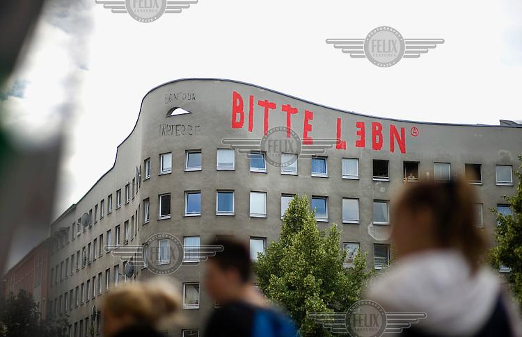 Graffiti Bitte Leben (Life, please) on a building located near the project Mediaspree in Berlin Kreuzberg Friedrichshain.