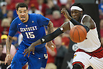 December 27, 2014- Center Willie Cauley-Stein of the Kentucky Wildcats steals the ball during the game against  the Louisville Cardinals at KFC Yum! Center in Louisville `, Ky. Kentucky defeated Louisville 58-50. Photo by Michael Reaves | Staff