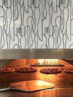 This custom commercial pizza oven features Forks Knives and Spoons, a handmade mosaic shown in Moonstone jewel glass from the Erin Adams Collection for New Ravenna.