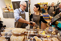 Pictured: Jeremy Corbyn serves a welsh cake at Awesome Wales, a zero waste shop in Barry. Saturday 07 December 2019<br /> Re: Labour Party leader Jeremy Corbyn pre-election campaign in Barry, south Wales, UK.