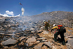 07-06-news-RIP-01.jpg.Brad Prancevic, right, from the El Cariso Hotshots is among 90 firefighters battling the 20-acre Spring (brush) fire near the Palm Springs Aerial Tramway on Tuesday, July 18, 2006.