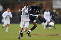 Virginia Cavaliers Tony Tchani (23) plays the ball in front of Akron Zips Blair Gavin (7). The Virginia Cavaliers defeated the Akron Zips 3-2 in a penalty kick shoot out after a scoreless game and overtime in the finals of the 2009 NCAA Men's College Cup at WakeMed Soccer Park in Cary, NC on December 13, 2009.