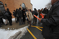 A man distributes stickers for vehicles in the funeral procession after the funeral of housing activist Beauty Turner, 51, a one-time resident of the Robert Taylor Homes who led the Beauty Turner Ghetto Bus Tour and received national recognition in publications such as The Wall Street Journal, in the parking lot of the Greater Harvest Missionary Baptist Church on South State Street in Chicago, Illinois on December 26, 2008.  Turner died of an aneurysm on December 18.