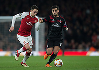 Mesut Ozil of Arsenal Suso of AC Milan during the UEFA Europa League round of 16 2nd leg match between Arsenal and AC Milan at the Emirates Stadium, London, England on 15 March 2018. Photo by Vince  Mignott / PRiME Media Images.