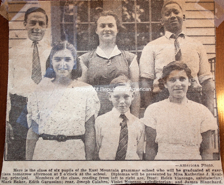 WATERBURY CT.-OCTOBER 16 2013 101613DA06- Violet Codianni, of Waterbury is top center, of a newspaper clipping of her graduating class of 1939 outside the building of what use to be East Mountain School in Waterbury which is now Employers Reference Source, Inc.Darlene Douty Republican American