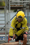 Vancouver, Canada, Aug 6th 2009.  World Police and Fire Games, Ultimate Firefighter Competition. Competitor Leon L. Berthelsen of the Western Australia Fire Brigade sets the axe into the log during the Weight and Strength Stage of the competition.  Photo by Gus Curtis