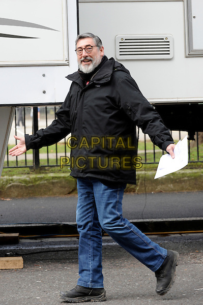 "JOHN LANDIS.On the set of ""Burke and Hare"", Lincoln's Inn, London, England..March 8th, 2010.director film movie full length jeans denim black jacket walking beard facial hair hands.CAP/IA.©Ian Allis/Capital Pictures."