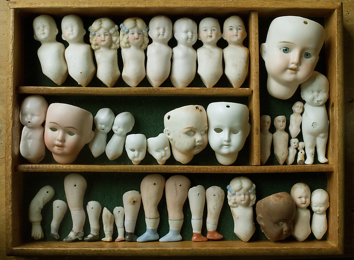 An artfully displayed collection of antique china [bisque] doll parts. These were recovered from the site of the old Limbach porcelain factory in the Thunguria region of Germany. They date from around 1880-1900.