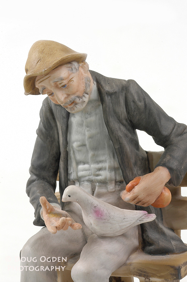 Old man feeding bird, detail.  Images used in Estate valuation and auction program.