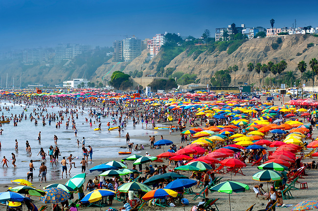 Summertime brings many people to the Playa Agua Dulce, a popular beach in the district of Chorrillos on the Costa Verde of Lima, Peru.