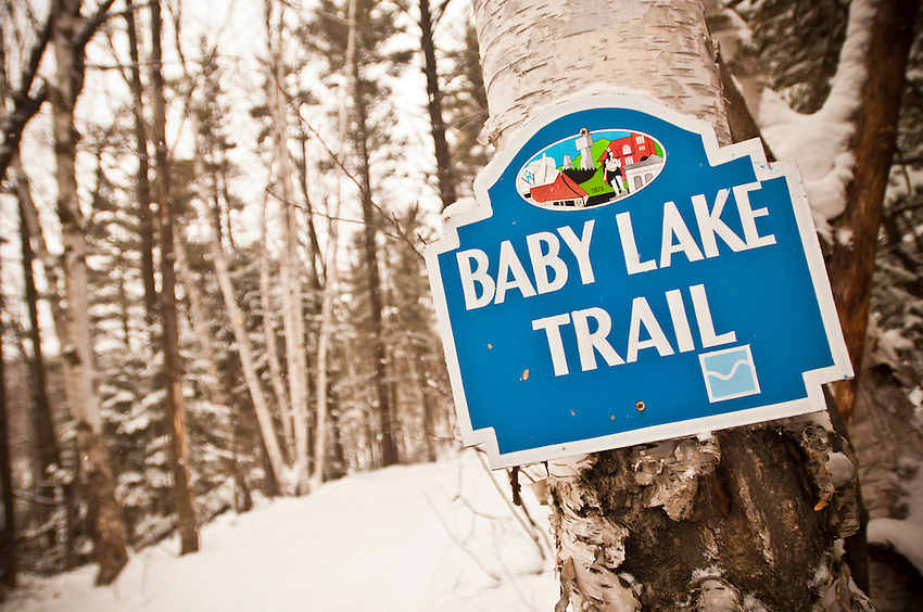 Sign for the Baby Lake Trail at the Al Quaal Recreation Area a skiing and hiking trail spot in Ishpeming Michigan.