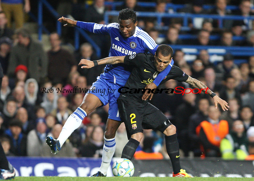 Daniel Alves of Barcelona and John Obi Mikel of Chelsea - Chelsea vs Barcelona, Champions League Semi-Final 1st Leg at Stamford Bridge, Chelsea - 18/04/12 - MANDATORY CREDIT: Rob Newell/TGSPHOTO - Self billing applies where appropriate - 0845 094 6026 - contact@tgsphoto.co.uk - NO UNPAID USE..
