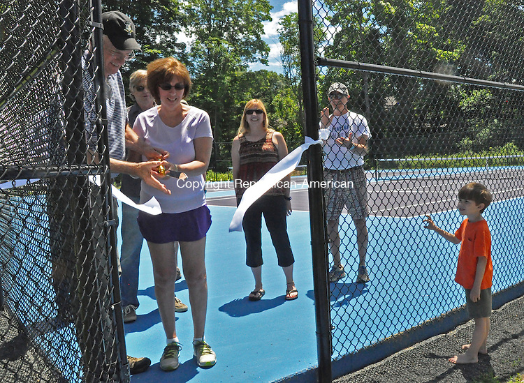 KENT, CT – 21 June 2014 - 062114LMW01 – First Selectman Bruce K. Adams and Park and Recreation Director Lesly Ferris cut the ribbon officially opening the tennis courts for play at Kent Common Park Saturday afternoon. Behind them are members of the Park and Recreation Commission and looking on is Chase Harrington. Lynn Mellis Worthington Republican-American