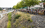 Waterfront cafes on Waalkade, River Waal, Nijmegen, Gelderland, Netherlands