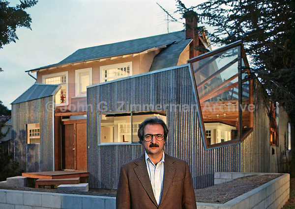 Architect Frank Gehry in front of his house, Santa Monica, CA, 1978. Photo by John G. Zimmerman.