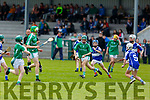 Ballyduff's Ray McGrath in possession as St Brendans Hugh Lenihan chases him, in the U14 Feile A Hurling Final in Abbeydorney on Monday.