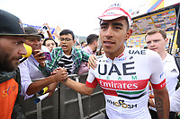 TUNJA - COLOMBIA, 13-02-2020:  Juan Sebastian Molano Benavides (COL) UAE TEAM EMIRATES, saluda al público tras ganar la tercera etapa del Tour Colombia 2.1 2020 con un recorrido de 177,7 km que se corrió entre Paipa y Sogamoso, Boyacá. /  Juan Sebastian Molano Benavides (COL) UAE TEAM EMIRATES, shake hands with the followers after winning the third stage of 177,7 km as part of Tour Colombia 2.1 2020 that ran between Paipa and Sogamoso, Boyaca.  Photo: VizzorImage / Darlin Bejarano / Cont
