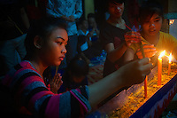 Early morning offering and prayers during a festival in a Buddhist Temple and Monastery, Battambang, Cambodia.