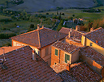 Tuscany, Italy: Montepulciano's colorful buildings and tiled roofs with rolling countryside hills in the background