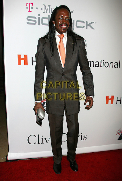 VERDINE WHITE of Earth, Wind & Fire.51st Annual GRAMMY Awards - Salute To Icons: Clive Davis Pre-Grammy Gala held at the Beverly Hilton Hotel, Beverly Hills, California, USA..February 7th, 2009.full length brown suit grey gray orange peach tie.CAP/ADM/MJ.©Michael Jade/AdMedia/Capital Pictures.