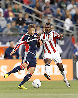 New England Revolution defender Chris Tierney (8) works to clear ball as Chivas USA midfielder Miller Bolanos (17) closes. In a Major League Soccer (MLS) match, the New England Revolution tied Chivas USA, 3-3, at Gillette Stadium on August 29, 2012.