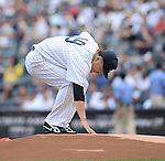 Masahiro Tanaka (Yankees), JUNE 22, 2014 - MLB : Masahiro Tanaka of the New York Yankees touches the pitcher's plate during the Major League Baseball game against the Baltimore Orioles at Yankee Stadium in the Bronx, NY, USA. (Photo by AFLO)