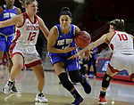 VERMILLION, SD: JANUARY 13:  Anna Lappenkuper #12 of Ft. Wayne drives between South Dakota defenders Jaycee Bradley #12 and Allison Arens #10 during their Summit League game Saturday January 13 at the Sanford Coyote Sports Center in Vermillion, S.D.   (Photo by Dick Carlson/Inertia)