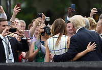 United States President Donald J. Trump and First Lady Melania Trump pose for the guests at the Congressional Picnic on the South Lawn  of the White House in Washington, DC, on June 22, 2017. <br /> Credit: Olivier Douliery - Pool via CNP /MediaPunch