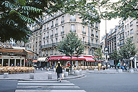 Paris: Two cafes at intersection of four boulevards at Edgar Quinet Metro stop. Radial avenues & round points afford cafe frontages. Photo '90.