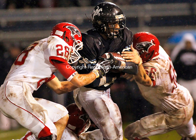 Ansonia, CT- 15, October 2010-101510CM10 Ansonia's Arkeel Newsome carries the ball through Wolcott defender's, Nieco Christiano (#28) and Matt Williams (#56).  Chargers went onto win, 39-20.  Christopher Massa Republican-American