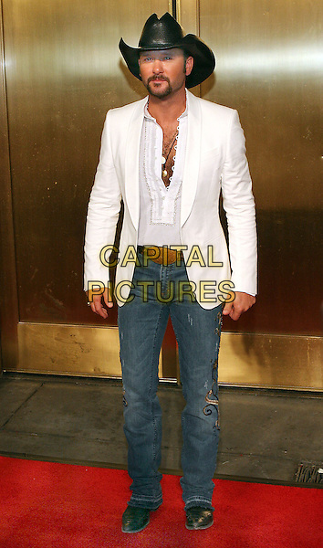 TIM MCGRAW.At Fashion Rocks held at Radio City Music Hall,.New Tork, 8th September 2005.full length white jacket denim jeans shirt black cowboy hat beard mustache.Ref: ADM/JL.www.capitalpictures.com.sales@capitalpictures.com.© Capital Pictures.