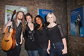 Musician Newton Faulkner with girl group The Lorelles. Busking at London Bridge Station. Rhythm of London 2011, Busking Underground competition is underway and the hunt is on to find London's most talented young musicians.
