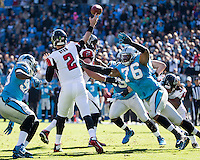 The Carolina Panthers defeated the Atlanta Falcons 34-10 in an inter-division rivalry played in Charlotte, NC at Bank of America Stadium.  Atlanta Falcons quarterback Matt Ryan (2) gets a pass off under pressure from Carolina Panthers defensive end Greg Hardy (76).