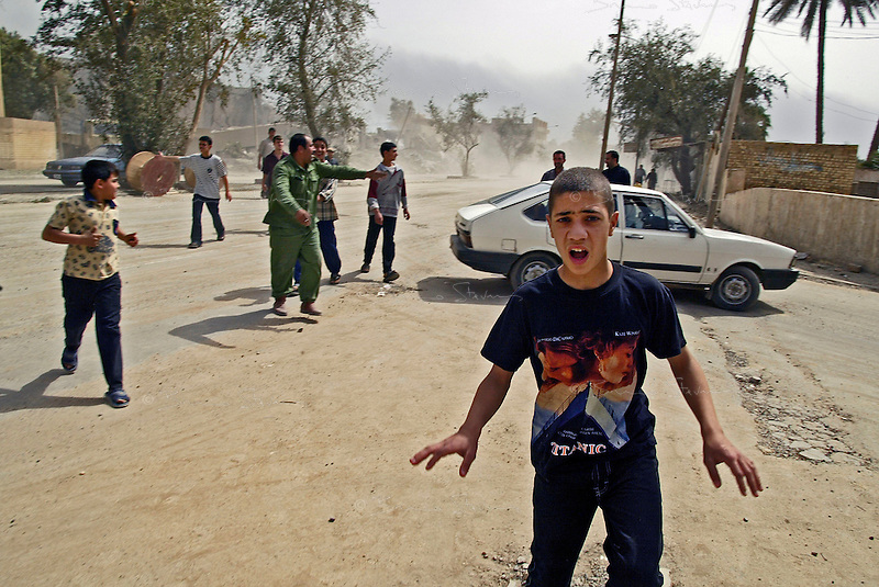 Baghdad, Iraq, April 5, 2003.Panic in the streets of Adamiyeh as US bombs fall near by during an air raid. Civilians in Baghdad are becoming very anxious as US forces approach the city, a substantial number are leaving to find refuge in the countryside.