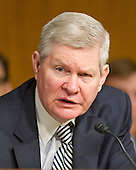 "United States Senator Tim Johnson (Democrat of South Dakota), Chairman, U.S. Senate Committee on Banking, Housing and Urban Affairs, listens to testimony from Janet L. Yellen, Chair, Board of Governors of the Federal Reserve System, on ""The Semiannual Monetary Policy Report to the Congress."" on Capitol Hill in Washington, D.C. on Tuesday, July 15, 2014.<br /> Credit: Ron Sachs / CNP"