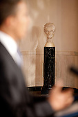 Washington, DC - June 1, 2009 -- A marble bust of President Abraham Lincoln is seen in the background as President Barack Obama makes an announcement about General Motors and the Auto Industry in the Grand Foyer of the White House, June 1, 2009..Mandatory Credit: Chuck Kennedy - White House via CNP