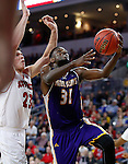 SIOUX FALLS, SD: MARCH 4: Garret Covington #31 of Western Illinois drives past Tyler Flack #23 of South Dakota on March 4, 2017 during the Summit League Basketball Championship at the Denny Sanford Premier Center in Sioux Falls, SD. (Photo by Dick Carlson/Inertia)