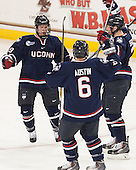 Evan Richardson (UConn - 19), Johnny Austin (UConn - 6), Ryan Segalla (UConn - 3) - The Boston College Eagles defeated the visiting University of Connecticut Huskies 3-2 on Saturday, January 24, 2015, at Kelley Rink in Conte Forum in Chestnut Hill, Massachusetts.