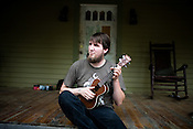 May 8, 2009. Durham, NC..Rich plays the ukulele at his house in Cleveland-Holloway.